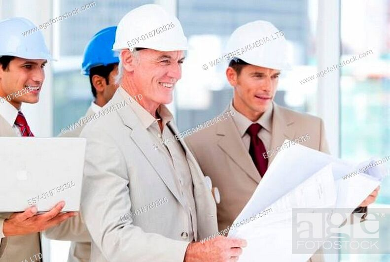 Stock Photo: Architect team working on a building project.