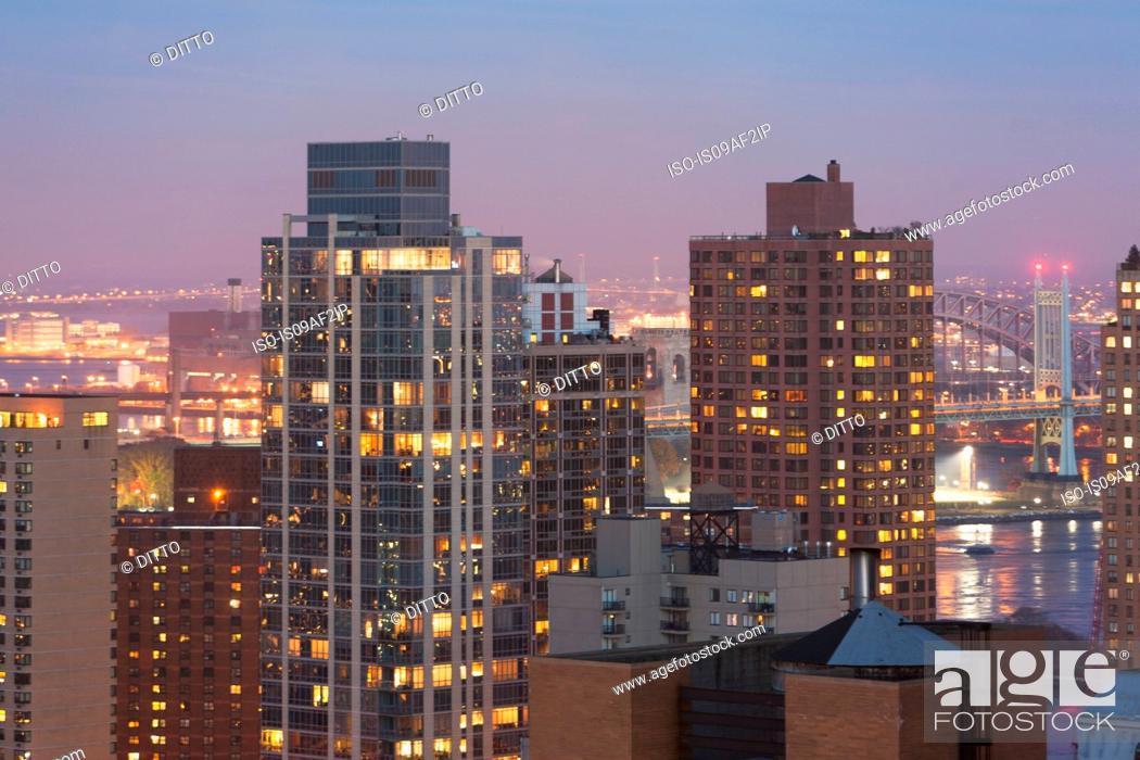 Stock Photo: Cityscape and Triborough bridge at dusk, New York City, USA.