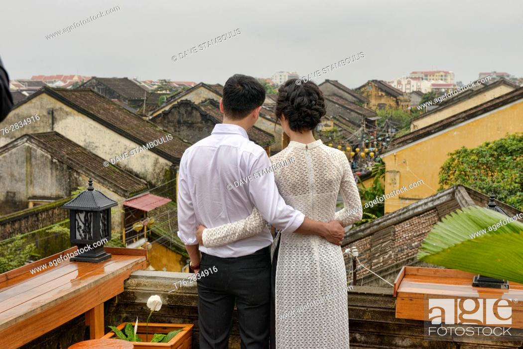 Stock Photo: Love on the rooftop, historic old district, Hoi An, Vietnam.