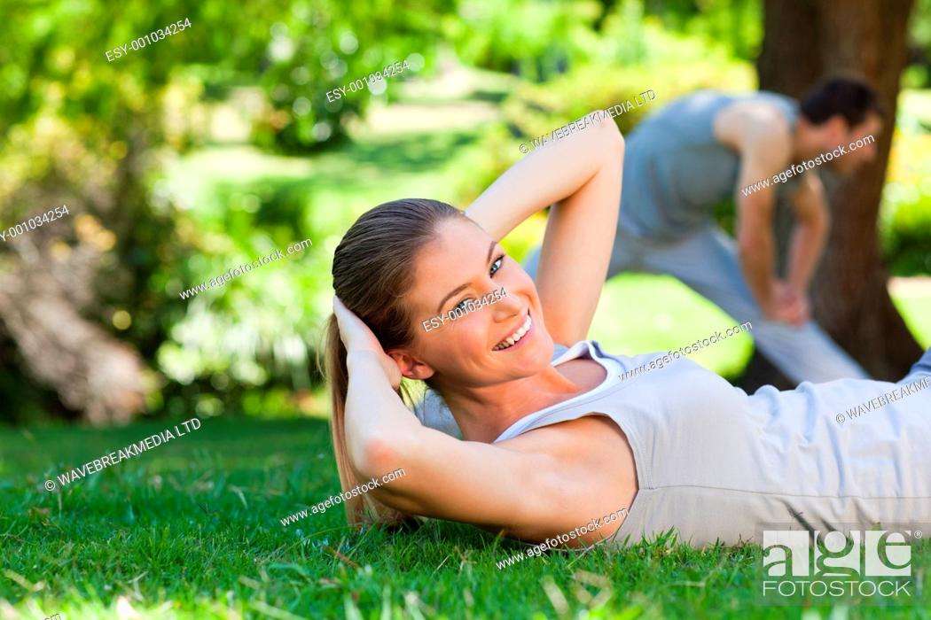 Stock Photo: Couple doing their stretches in the park.