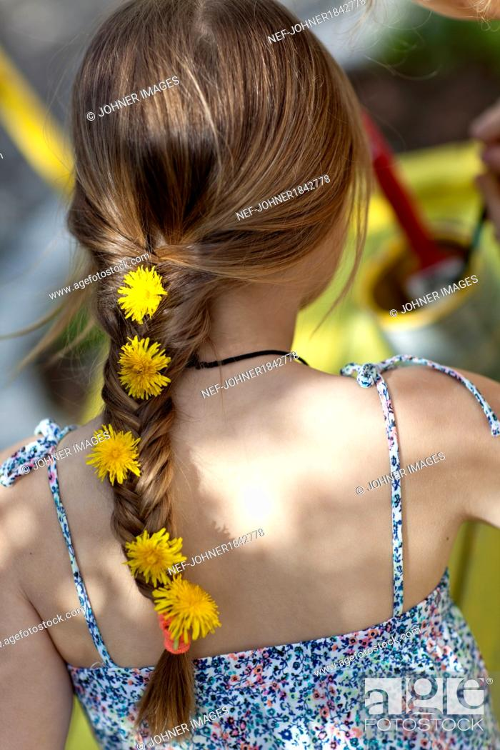 Stock Photo: Girl with dandelion flowers in braid.