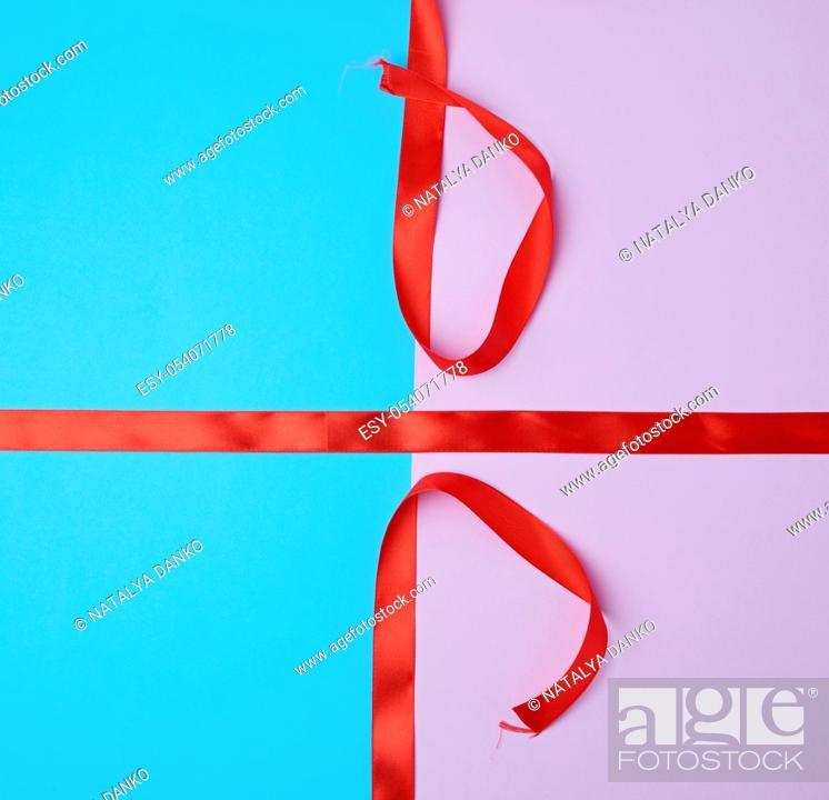 Stock Photo: red satin ribbon on a colored background, imitation of tying and packing a gift.