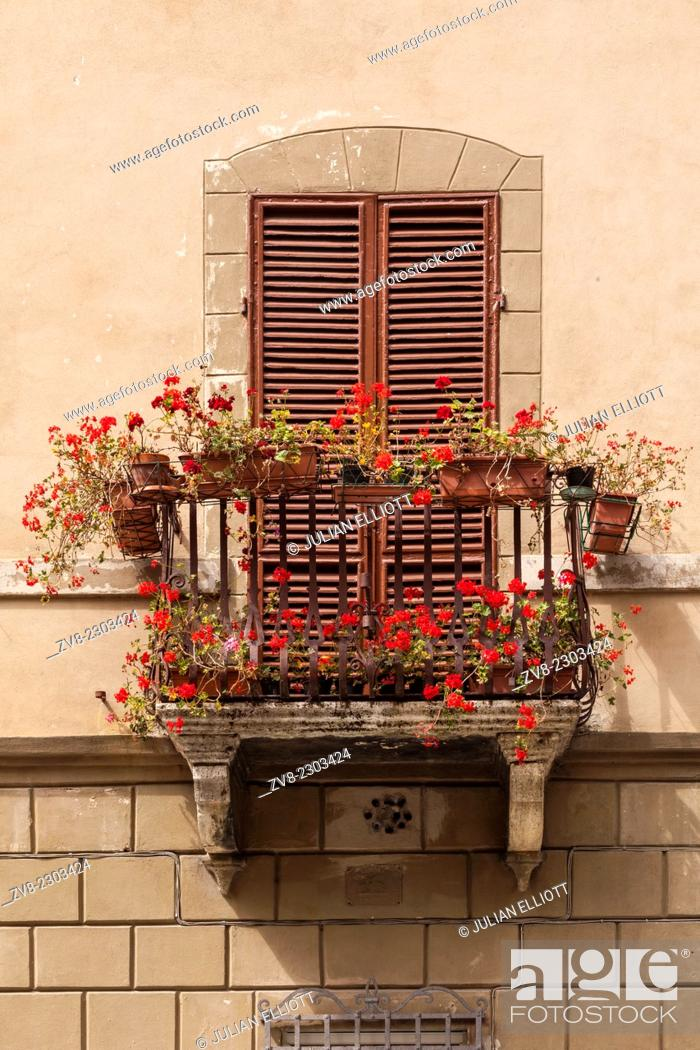 Stock Photo: An old window in Siena, Tuscany, Italy.