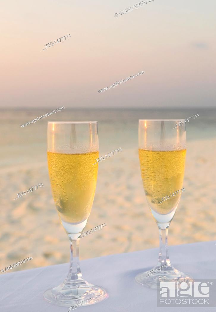 Stock Photo: Close-up of two champagne flutes at a beach in the Maldives.