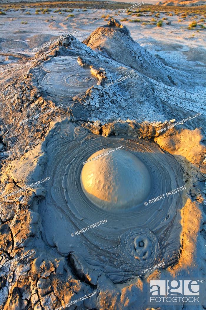 Stock Photo: Mud erupting from a mud volcano, Qobustan, Azerbaijan.