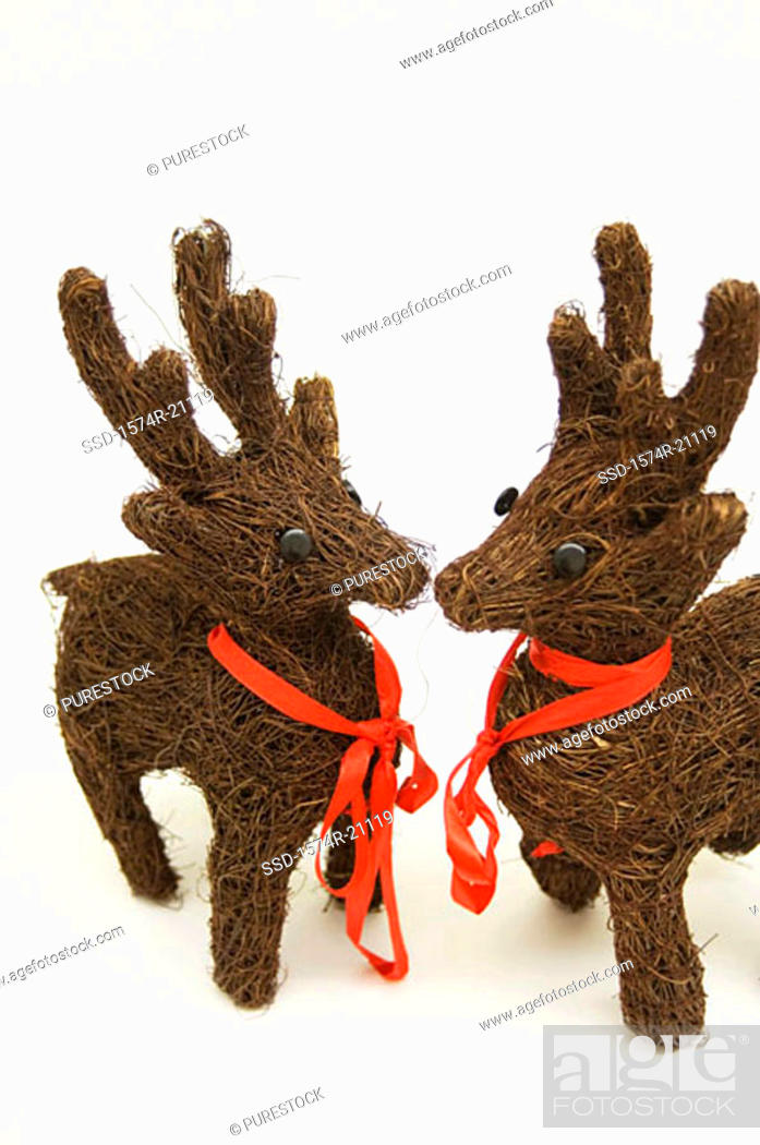 Stock Photo: Close-up of two reindeer decorations.