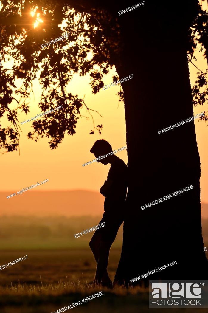 Stock Photo: Closeup portrait young man alone at sunset.