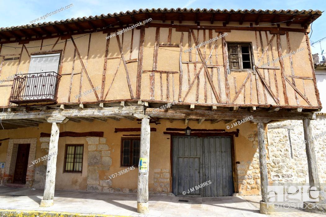 Stock Photo: Ampudia, arcaded traditional house (stone, adobe and wood). Tierra de Campos, Palencia province, Castilla y Leon, Spain.