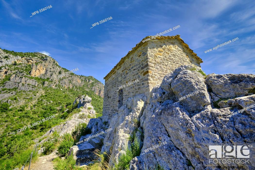 Stock Photo: Romanesque hermitage of Mare de Deu de la Pertusa in the way of the gorge Mont-rebei with Canelles reservoir in the bottom of Lleida Montsec.