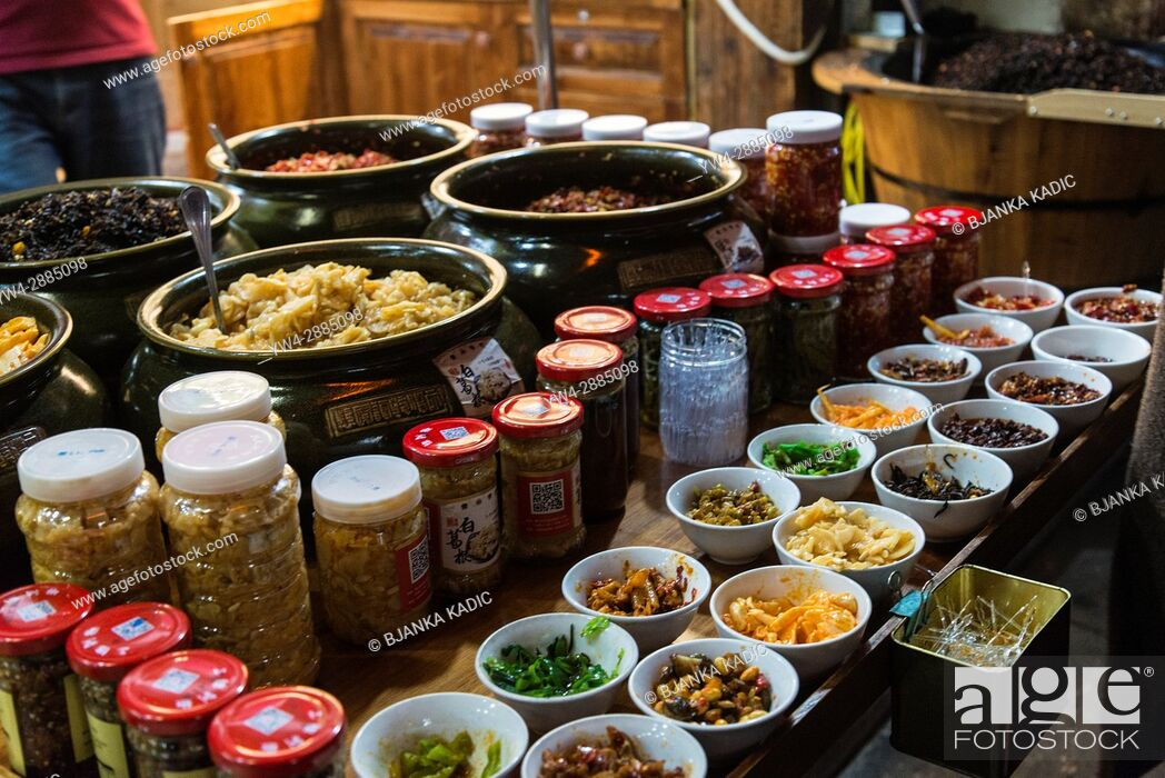 Stock Photo: Local food delicacies sold in the street, Tunxi Old Street, traditional shopping hub, Huangshan, Anhui province, China.
