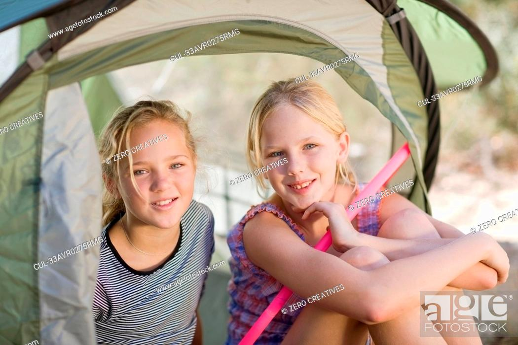 Stock Photo: Girls holding hula hoops in tent.