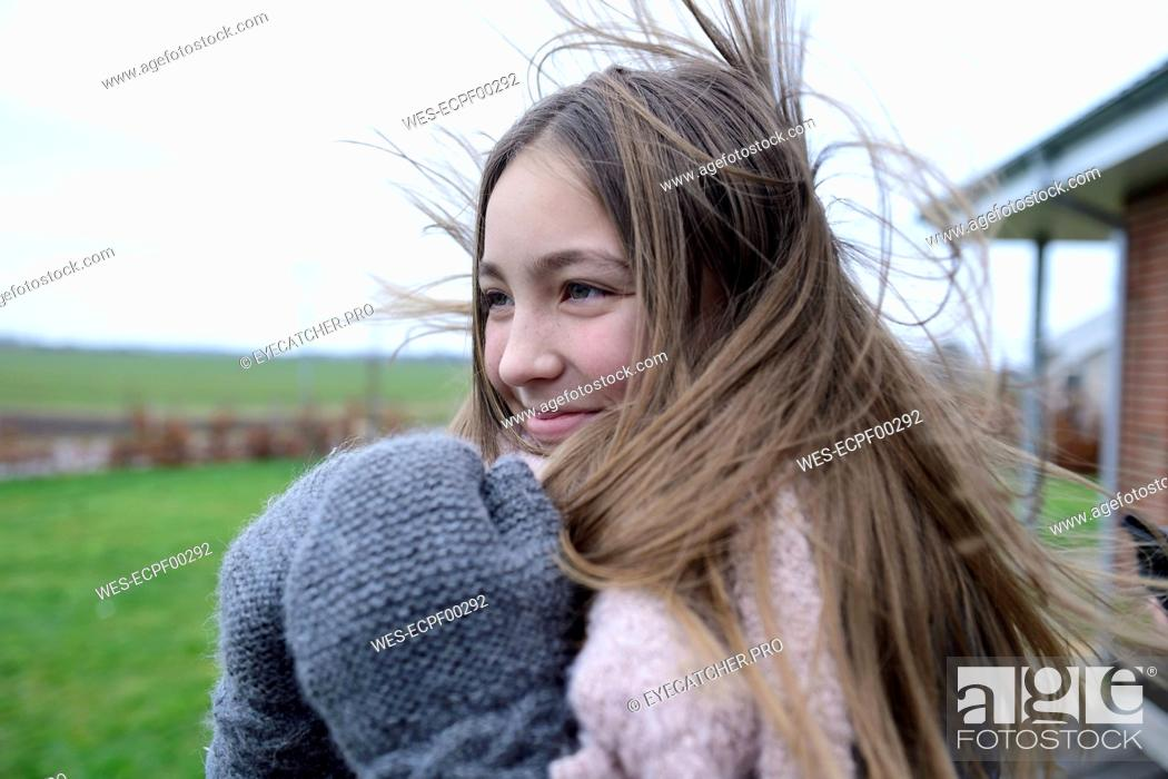 Photo de stock: Portrait of smiling girl with blowing hair in winter.
