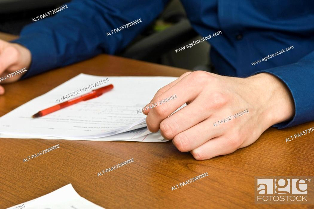 Stock Photo: Person reading document.