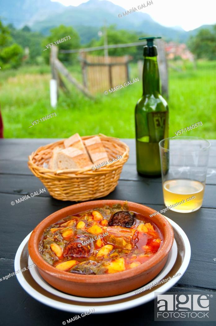 Stock Photo: Pote asturiano serving with cider. Asturias, Spain.
