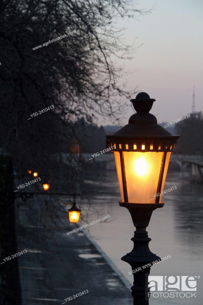 Stock Photo: Street lamp on ponte sisto bridge by the tiber river in trastevere rome italy.
