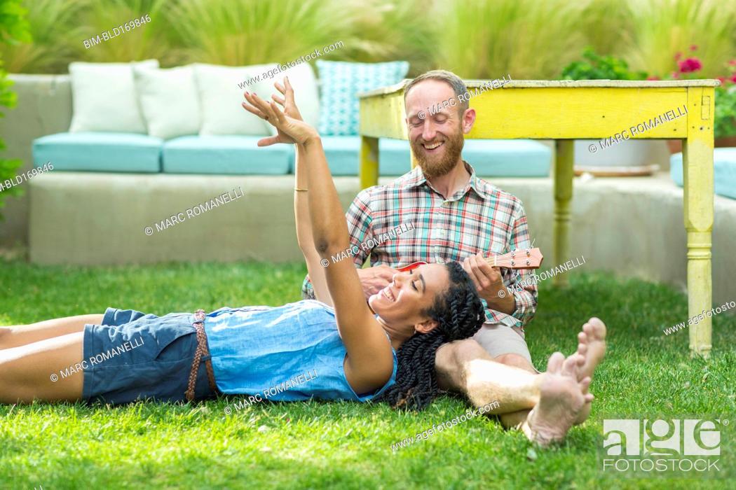 Stock Photo: Couple relaxing in backyard.