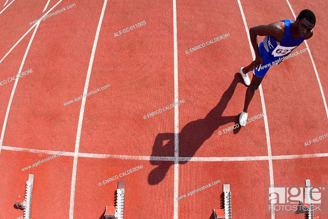 Stock Photo: Male Runner Approaching Starting Blocks.