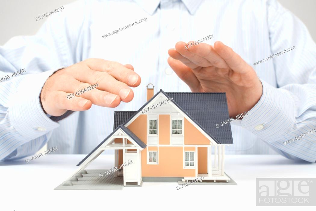 Stock Photo: Protect house - insurance concept.