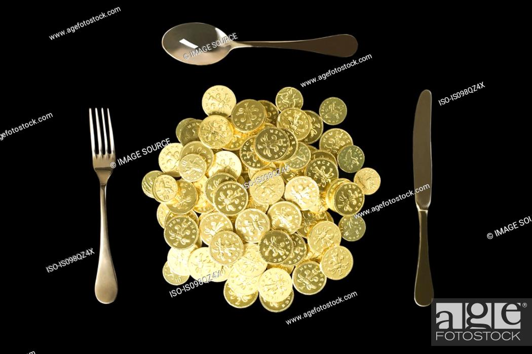 Stock Photo: Coins and cutlery.