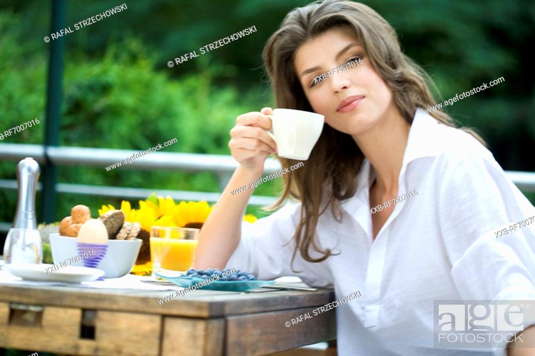 Stock Photo: Woman drinking tea on the terrace.