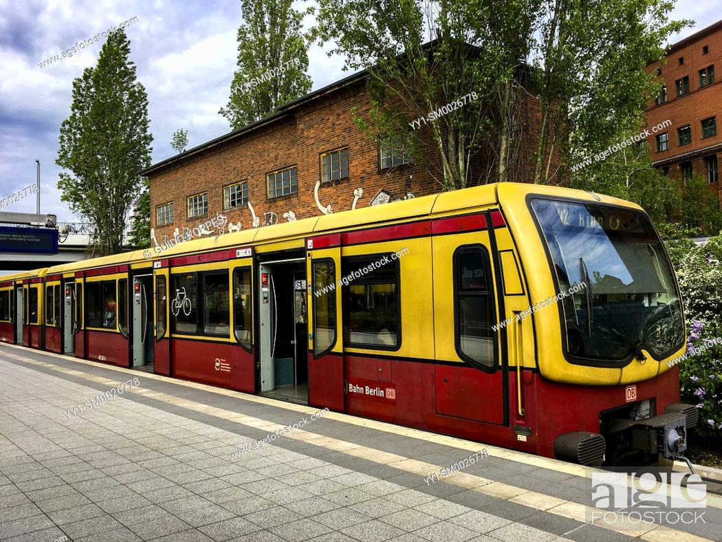 Stock Photo: Berlin, Germany. S-Bahn Subway Train making a stop at one of the many S-Bahn Stations inside the City.