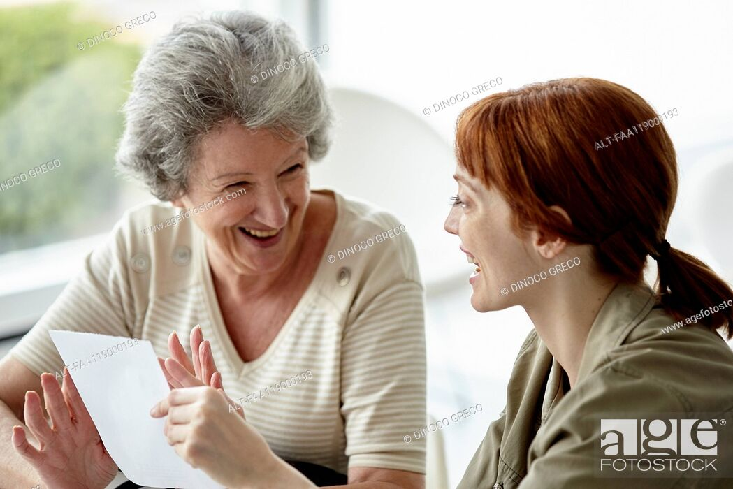 Stock Photo: Mother and daughter holding prescription.