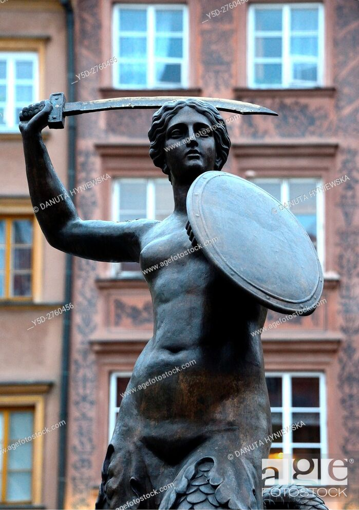 Stock Photo: Mermaid - Syrenka - Statue by Konstanty Hegel, symbol of Warsaw, located in the center of Old Town Market Place, Warsaw, Poland, Europe.