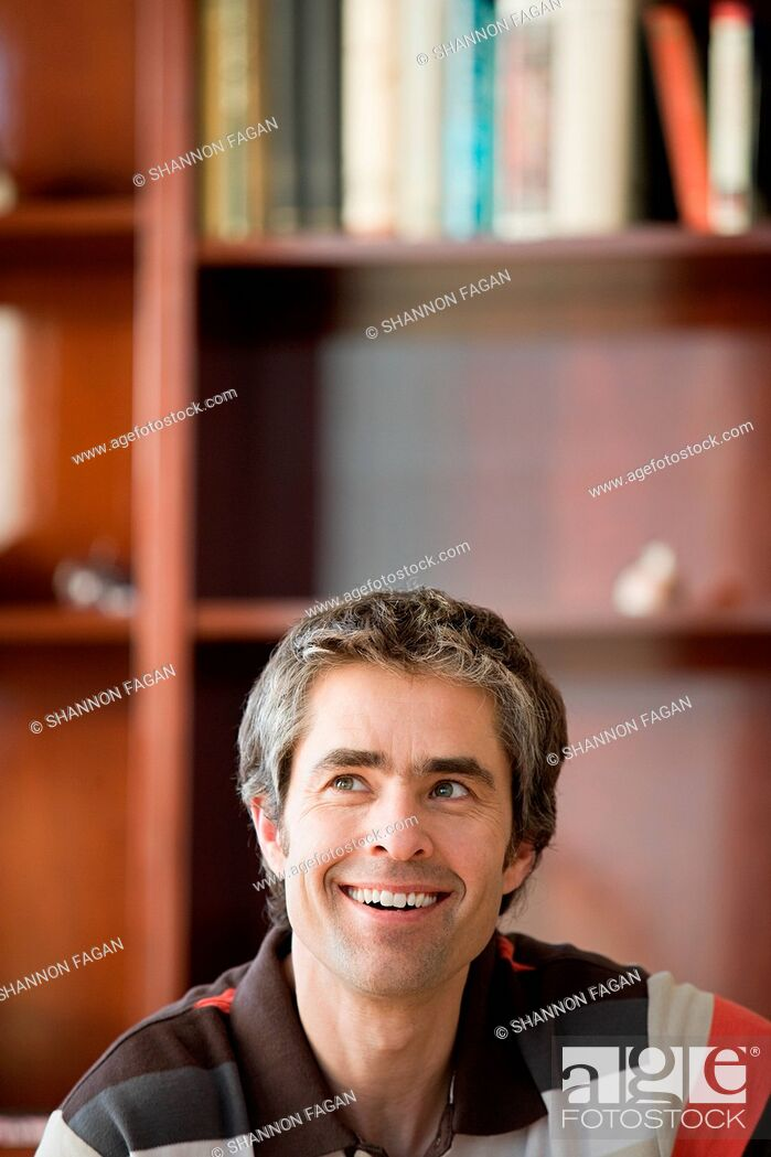 Stock Photo: man looking up.