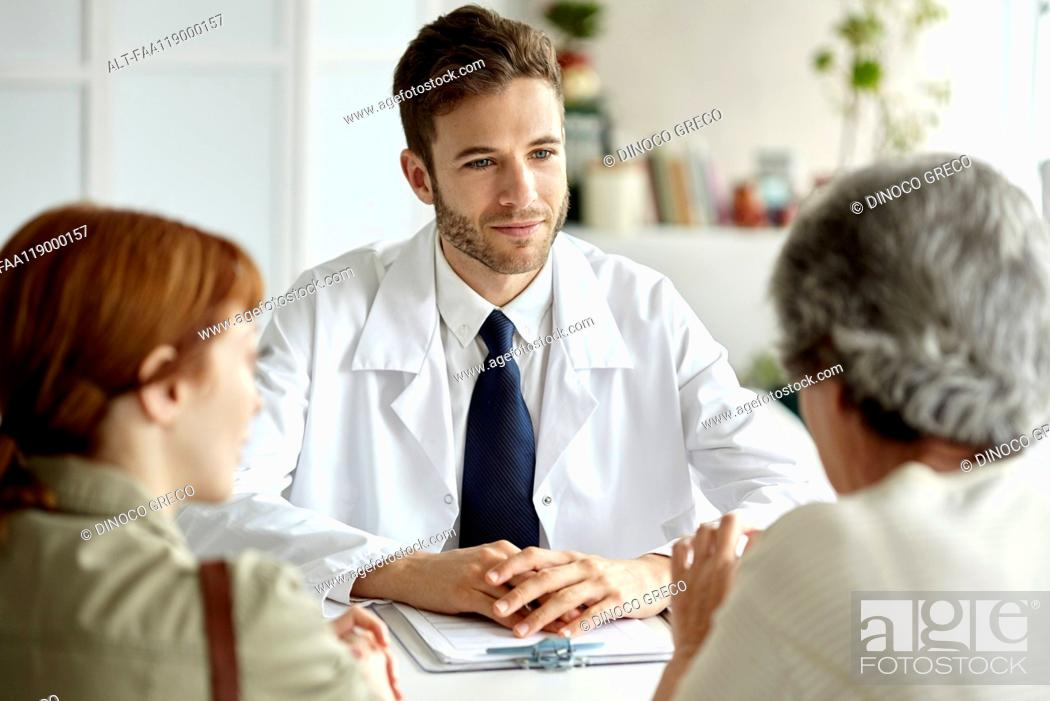Stock Photo: Senior patient talking with doctor.