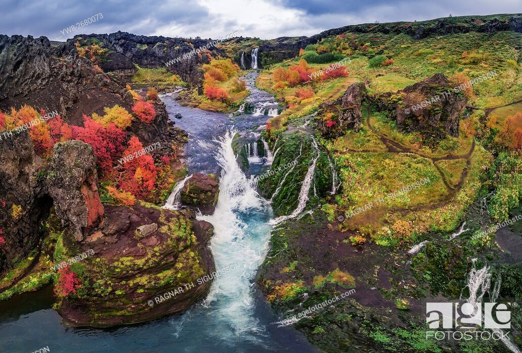 Stock Photo: From above lava and moss landscape in the autumn, Gjaarfoss in the Thjorsardalur valley, Iceland. This image is shot with a drone.