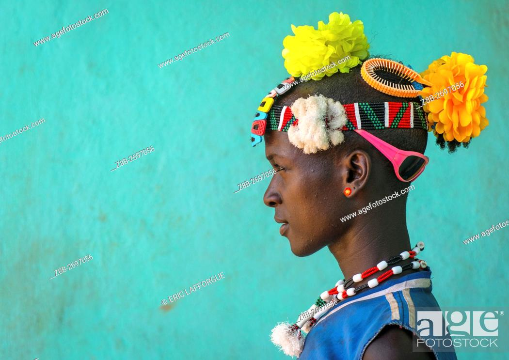 Stock Photo: Ethiopia, Omo Valley, Key Afer, profile of a bana tribe man with plastic flowers in the hair.