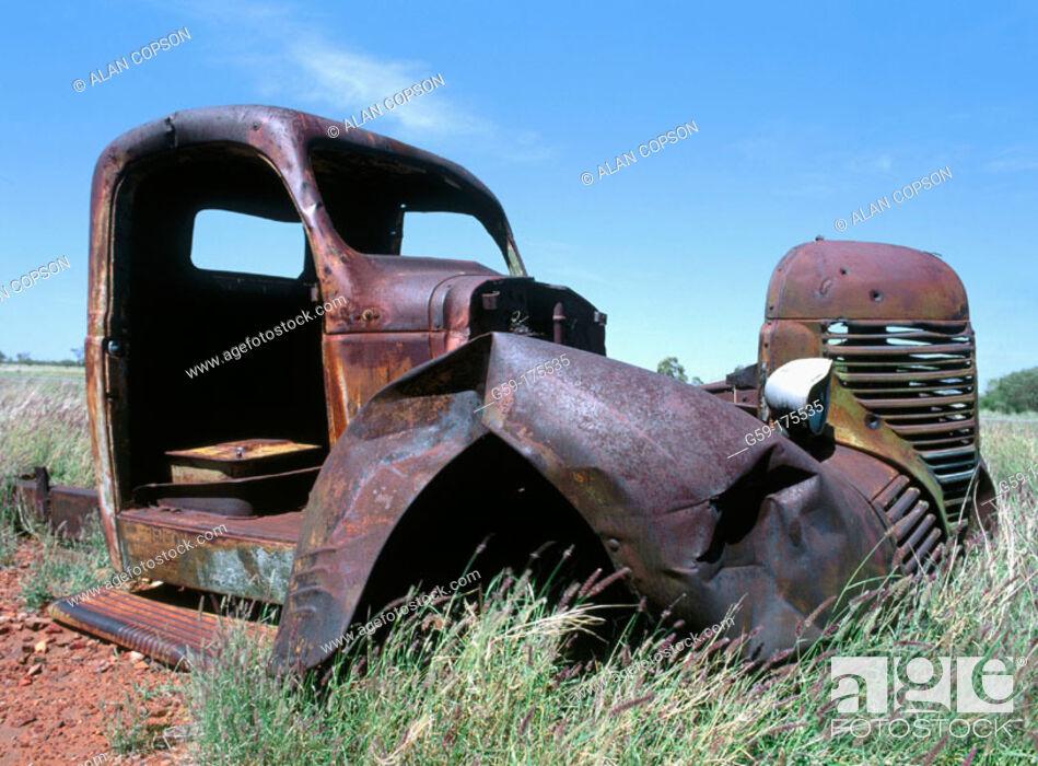 Stock Photo: Abandoned car. Stuart Highway near Wauchope. Northern Territory, Australia.