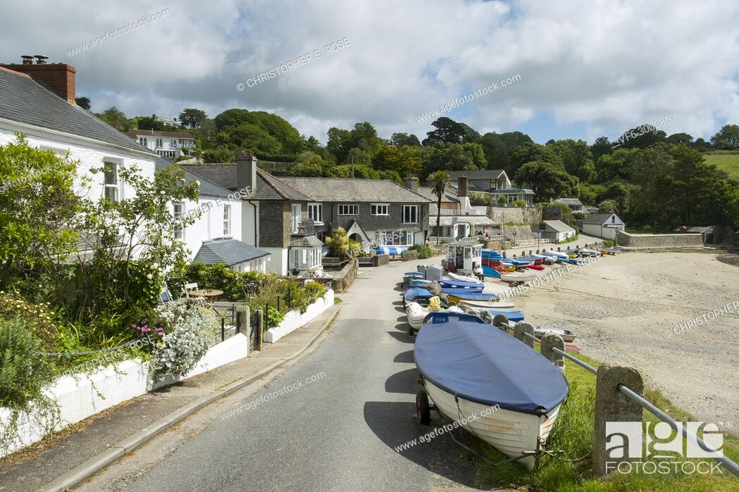 Stock Photo: Many colourful small boats line up along the roadside beach edge in the popular launching place of Helford Passage, Cornwall, UK.