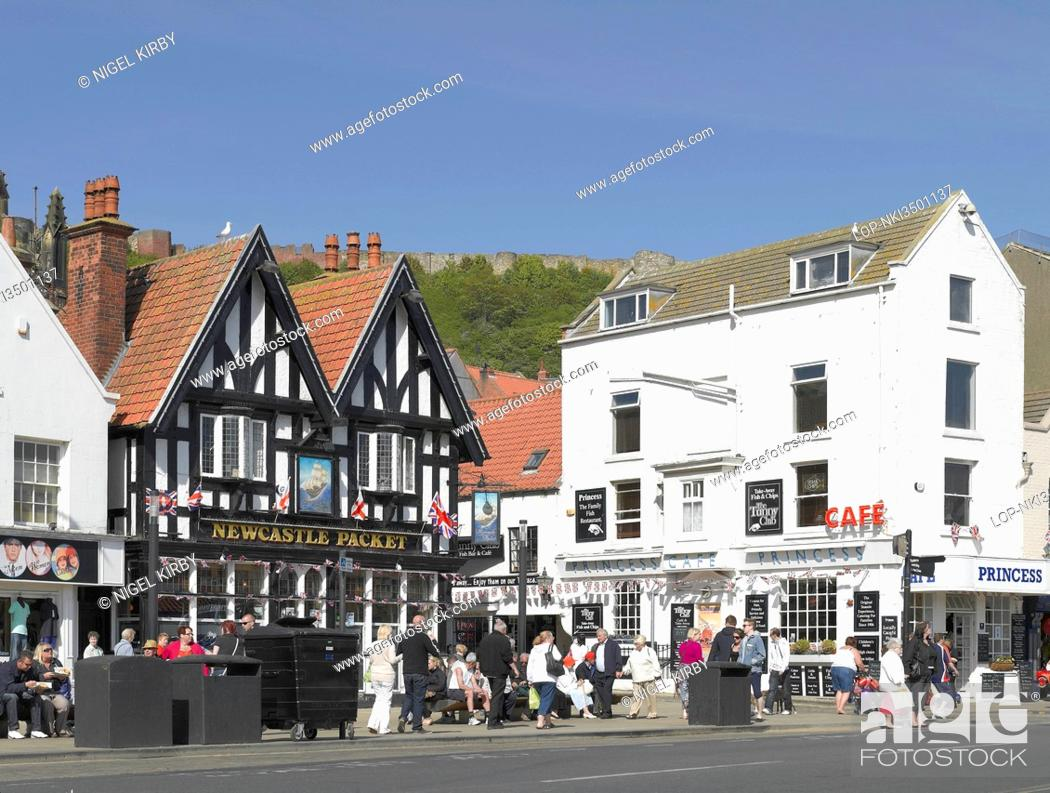 Stock Photo: England, North Yorkshire, Scarborough. Bars and cafes along Foreshore Road on the seafront at Scarborough.