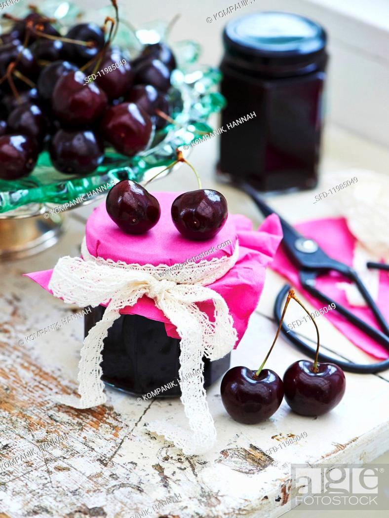 Stock Photo: Cherry jam in a glass.