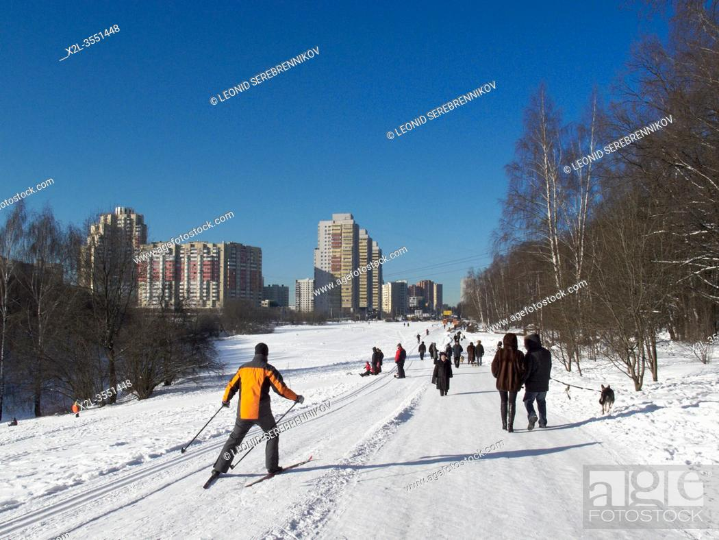 Stock Photo: Man skiing in Bitsevski Park (Bitsa Park) on a sunny winter day. Moscow, Russia.