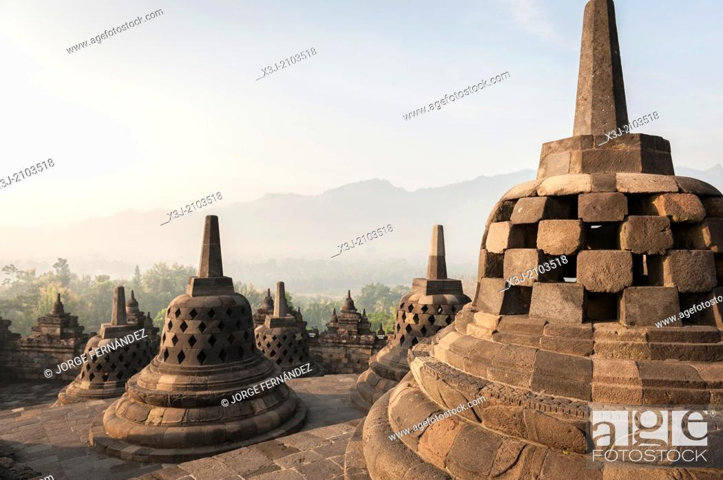 Stock Photo: Sunrising over the stupas of the Buddhist temple of Borobudur, Java, Indonesia.