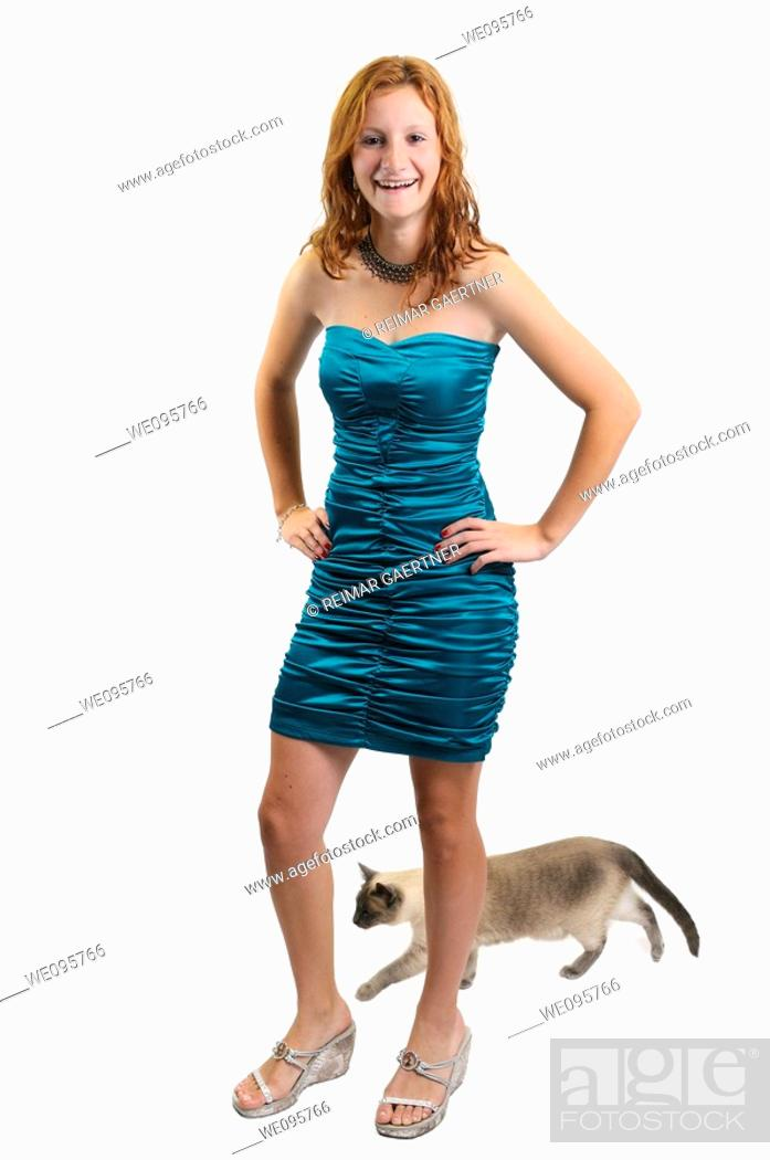Stock Photo: Cut out of teenage girl laughing while a siamese cat walks behind her.