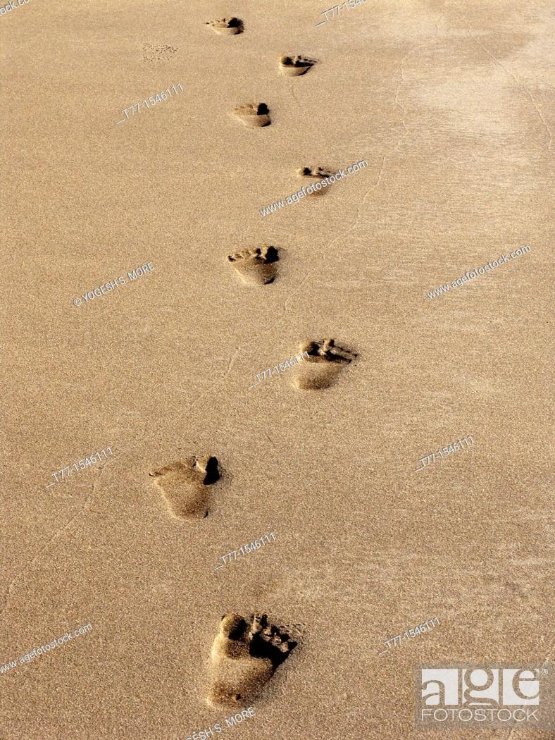Stock Photo: Footprints of a human being on sand at sea shore.
