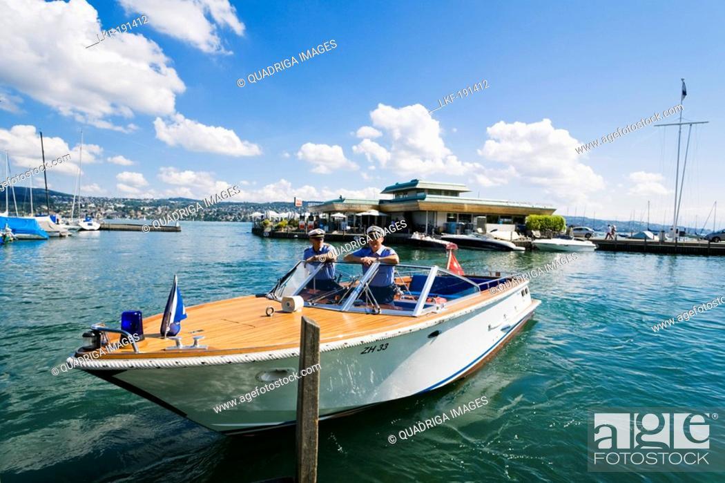 Stock Photo: Water guards in a boat near Seerose restaurant, Lake Zurich, Zurich, Switzerland.