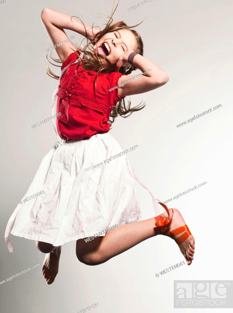 Stock Photo: Girl 10-11 jumping and shouting.