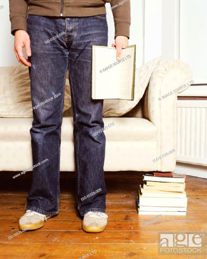 Stock Photo: A young man reading a book.