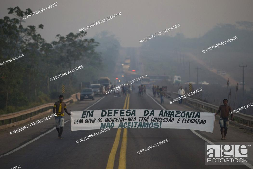 Stock Photo: 17 August 2020, Brazil, Novo Progresso: Members of the Kayapó indigenous people are blocking the BR-163 motorway and preventing vehicles from passing through.