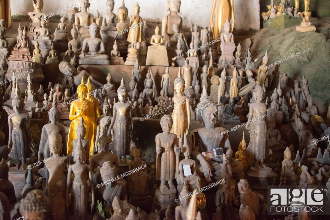 Stock Photo: Hundreds of Buddha statues have been brought to the Pak Ou Caves on the Mekong River in Laos.