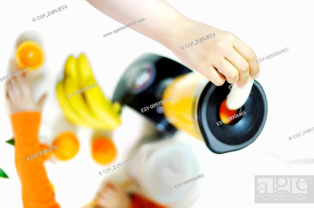Stock Photo: Blender making fruit juice at home.
