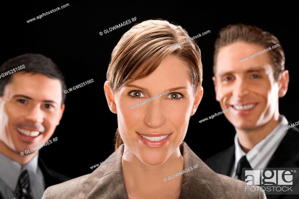 Stock Photo: Portrait of business executives smiling.