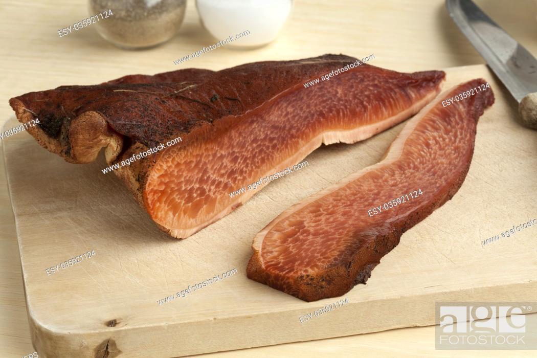 Stock Photo: Fresh slice of a beefsteak fungus on a cutting board.