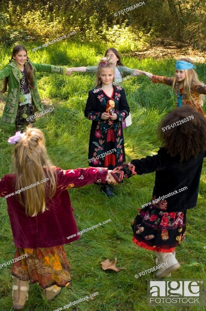 Stock Photo: Portrait of young girls outdoors.