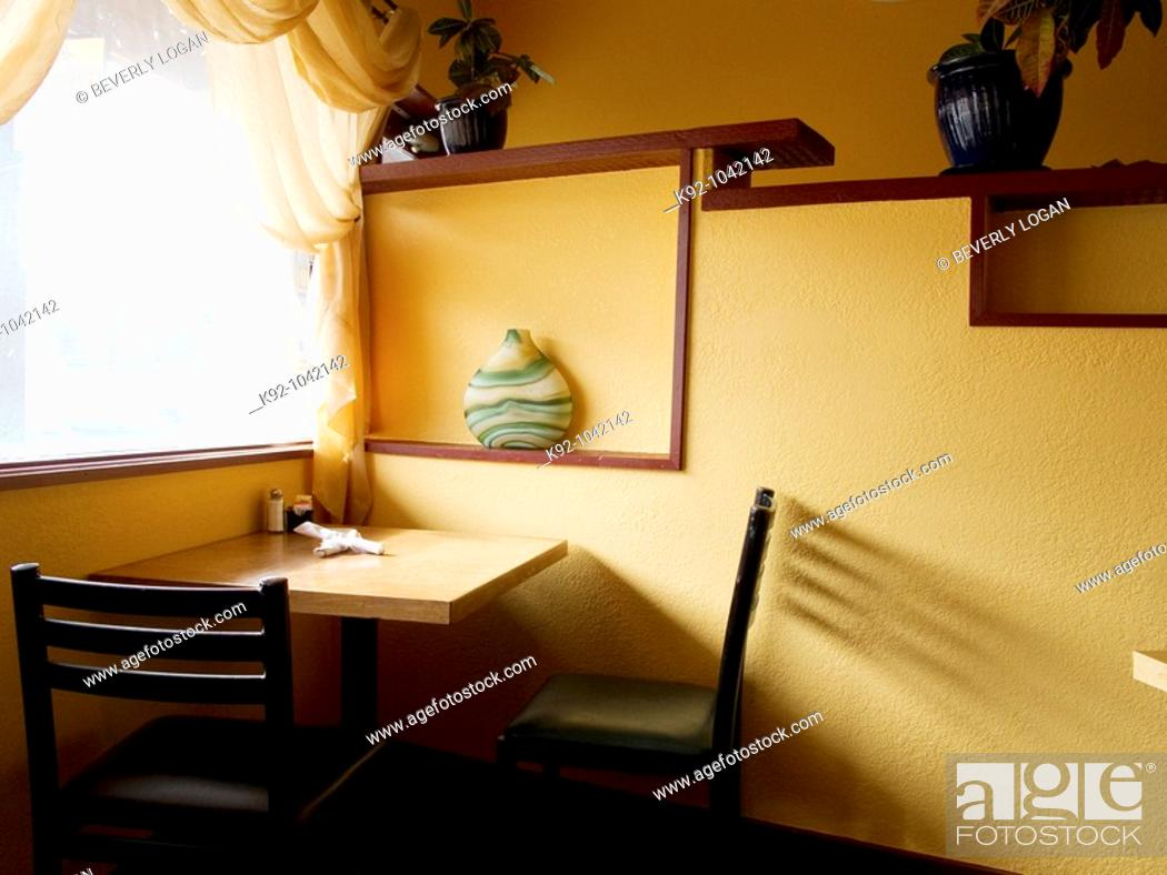 Stock Photo: Empty table and chairs in a restaurant in Colorado.