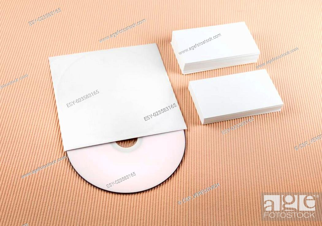 Stock Photo: Blank business cards and compact disk.